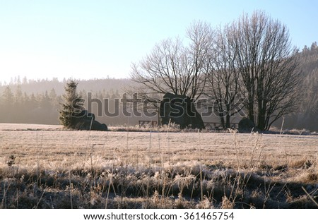 Table Mountains in Poland by winter, early morning. Single rock formations in the meadow. - stock photo