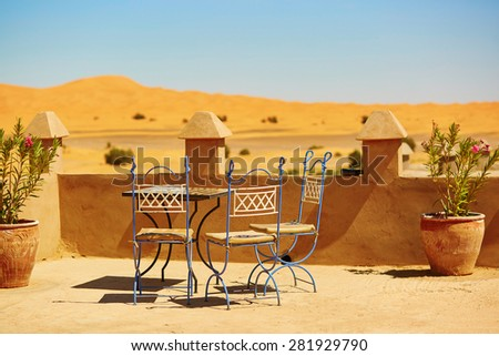 Table of a cafe in Merzouga village in Sahara desert, Morocco - stock photo
