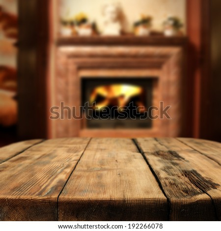 table of brown and interior with shadows and fireplace  - stock photo