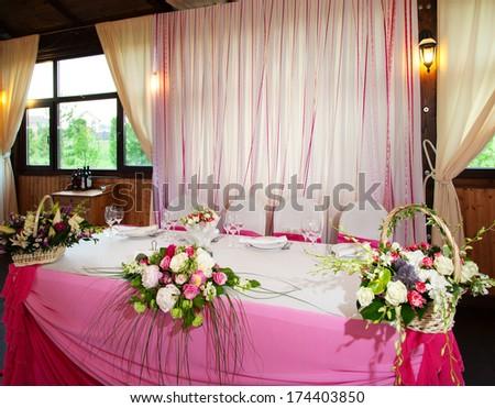 Table of newlyweds - stock photo