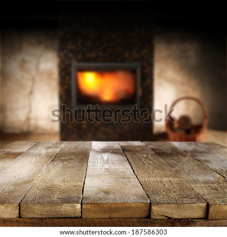 table of retro wooden texture and fireplace