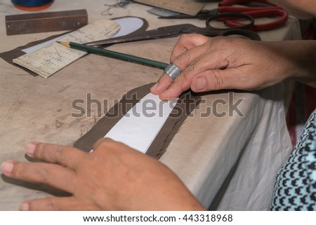 Table of skilled tailors working