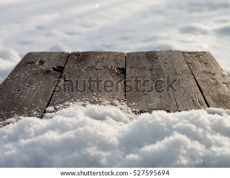 table of wood and snow