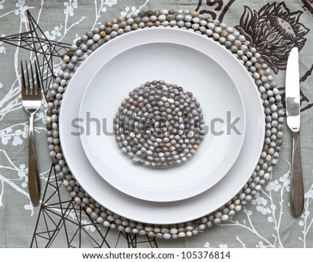 Table place setting with beaded mats - stock photo