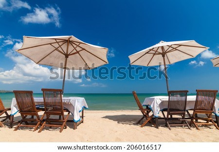 table set and umbrella on the beach