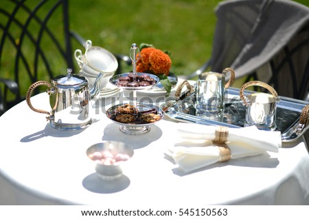 Table set for an English high tea or afternoon tea outside with silver teapot & Table Set English High Tea Afternoon Stock Photo (100% Legal ...