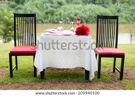Table set for an event party or wedding reception , riverside - stock photo