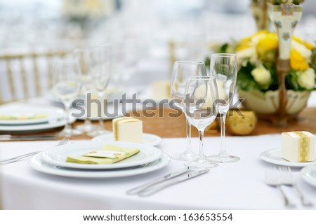Table set for an event party or wedding reception, summer theme - stock photo