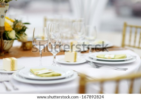Table set for an event party or wedding reception, summer theme