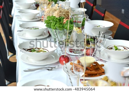 Table set for an event reception. food and drink