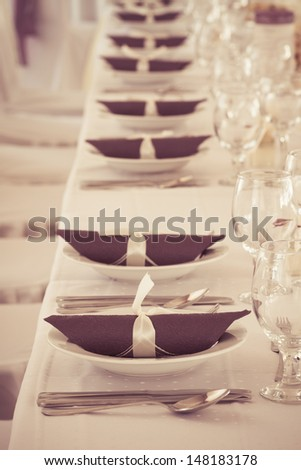 table set for event - colorized photo - stock photo