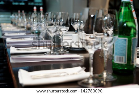 Table set for official dinner and presentation - stock photo