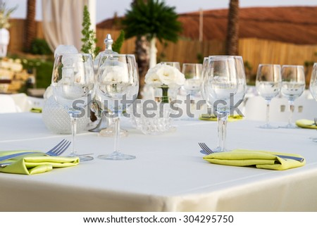 Table set for wedding or another catered event dinner .