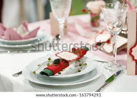 Table set  for wedding or event party with rose and berry decoration