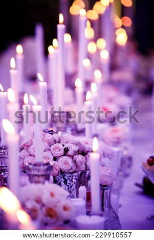 Table set for wedding reception with candles