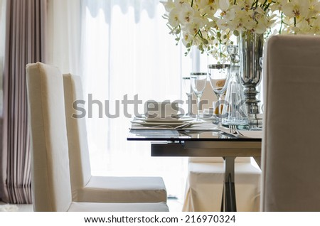 table set in white dinning room at home - stock photo