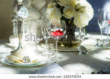 table set service with silverware and glass stemware at restaurant