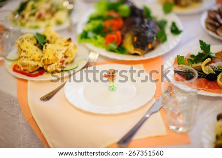 table set service with silverware and glass stemware at restaurant before party  - stock photo