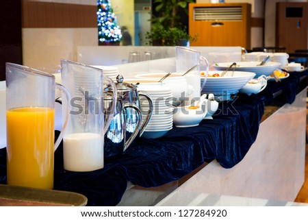 Table set up for continental breakfast - stock photo