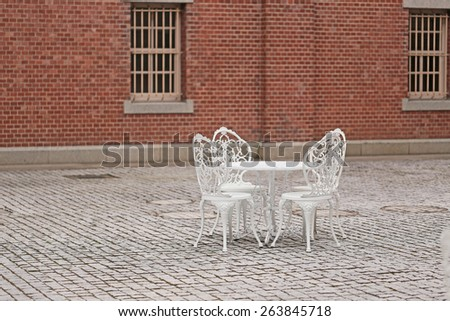 Table set with Red brick building