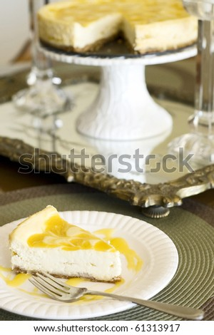 Table set with Swirled Mango Cheesecake Ready to Eat - stock photo