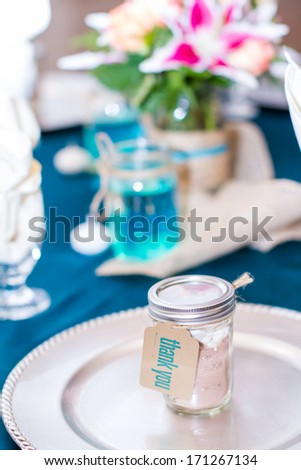 Table set with vintage gift jars for wedding reception.