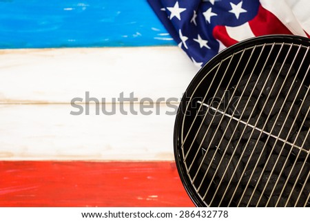 Table set with white, blue and red decorations for July 4th barbecue. - stock photo