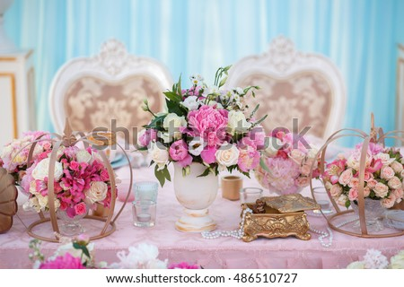 Table setting at a luxury wedding decorated with composition of flowers.