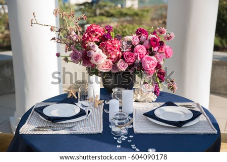 Table setting at a luxury wedding or another catered event. Marine themes & Blue White Hydrangea Table Setting Stock Photo 144335617 ...