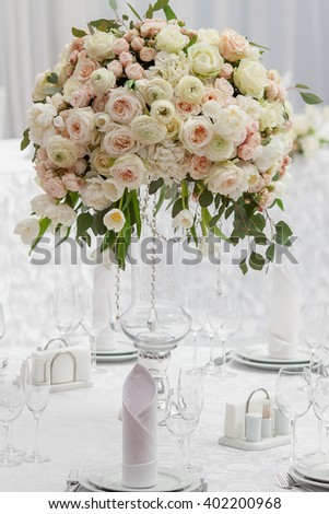 Table setting at a luxury wedding reception. Beautiful flowers on the table. - stock photo