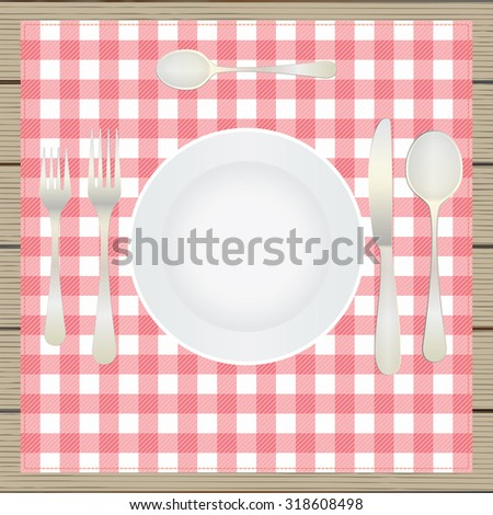 Table setting, etiquette. Top view. Plate, fork, spoon, knife, table-napkin, wooden table. - stock photo