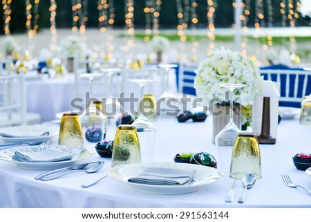Table setting for an event party or wedding reception at the beach - stock photo
