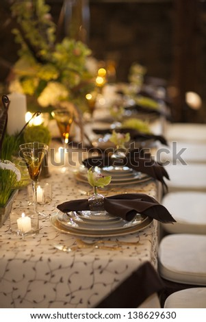 Table setting for dining at a high end wedding. - stock photo