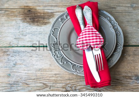 Table setting for St. Valentines day with glasses of wine, present box and red roses  in rustic style - stock photo