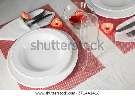 Table setting for two person with dishes and cutlery on pink napkin & Table Setting Two Person Dishes Cutlery Stock Photo (Safe to Use ...