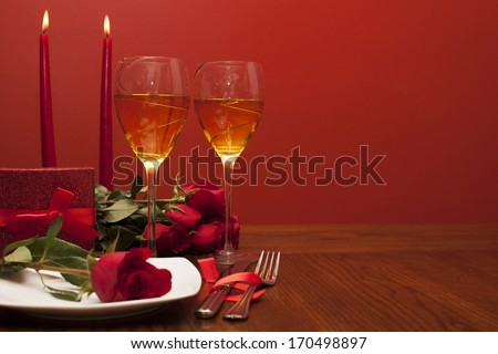 table setting for valentines day with roses