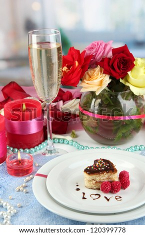 Table setting in honor of Valentine's Day on room background - stock photo