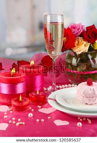 Table setting in honor of Valentine's Day on room background