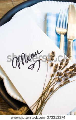 Table setting in rustic style with Menu