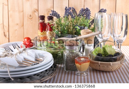 Table setting on checkered tablecloth on wooden background