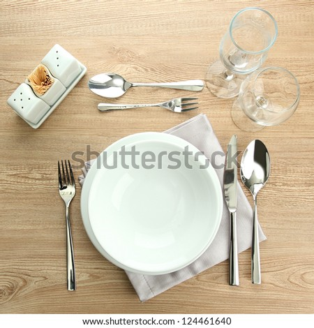 Table setting on wooden table - stock photo