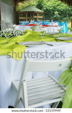 Table setting outside for wedding - stock photo