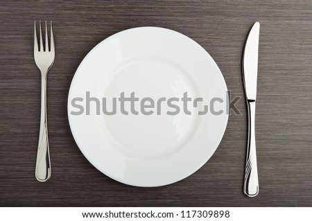 table setting. plate fork knife white empty - stock photo
