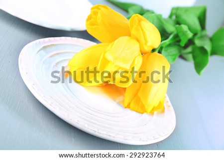 Table setting with flowers, closeup - stock photo