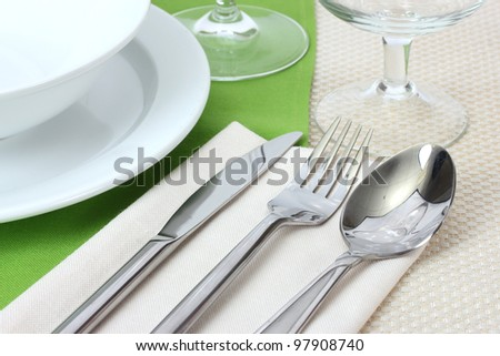 Table setting with fork knife spoon plates and napkin & Table Setting Fork Knife Spoon Plates Stock Photo (100% Legal ...