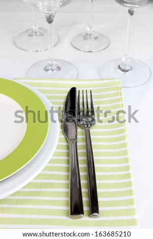 Table setting with glasses for different drinks on table close-up - stock photo