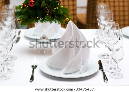 Table setting with plates and silverware - stock photo