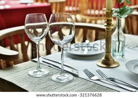 Table setting with wine glasses at the vintage cafe. - stock photo