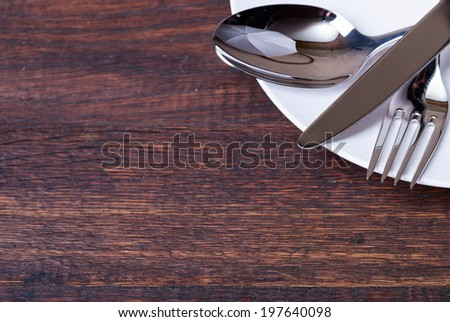 Table settings on wooden  background.