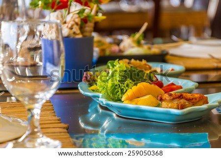 table setup in outdoor cafe, small restaurant in a hotel, summer vacations, meal time - stock photo